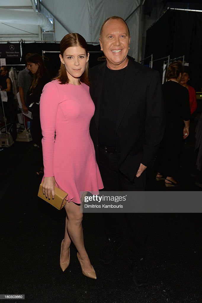 Actress <a gi-track='captionPersonalityLinkClicked' href=/galleries/search?phrase=Kate+Mara&family=editorial&specificpeople=544680 ng-click='$event.stopPropagation()'>Kate Mara</a> (L) and designer <a gi-track='captionPersonalityLinkClicked' href=/galleries/search?phrase=Michael+Kors+-+Fashion+Designer&family=editorial&specificpeople=4289231 ng-click='$event.stopPropagation()'>Michael Kors</a> pose backstage at the <a gi-track='captionPersonalityLinkClicked' href=/galleries/search?phrase=Michael+Kors+-+Fashion+Designer&family=editorial&specificpeople=4289231 ng-click='$event.stopPropagation()'>Michael Kors</a> fashion show during Mercedes-Benz Fashion Week Spring 2014 at The Theatre at Lincoln Center on September 11, 2013 in New York City.