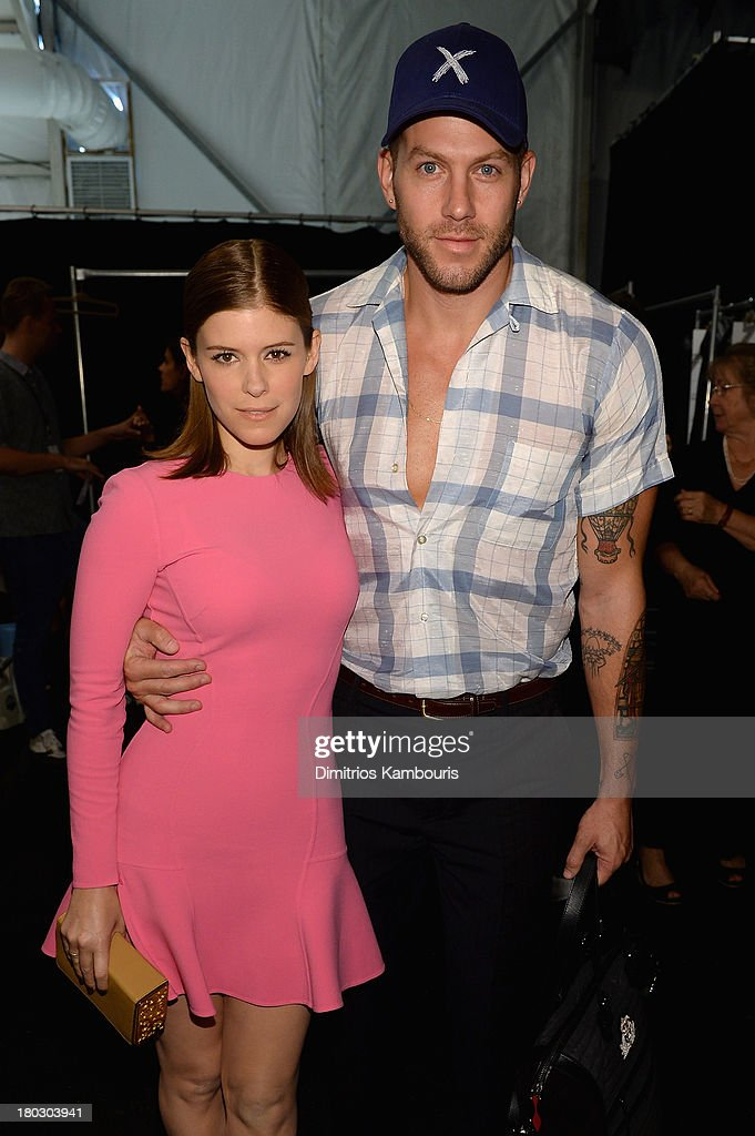 Actress Kate Mara and stylist Johnny Wujek pose backstage at the Michael Kors fashion show during Mercedes-Benz Fashion Week Spring 2014 at The Theatre at Lincoln Center on September 11, 2013 in New York City.
