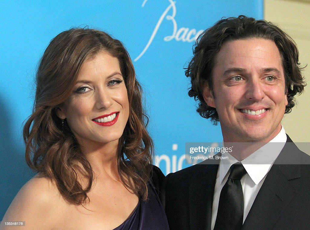Actress Kate Walsh (L) and her guest attend The 2011 Unicef Ball at The Beverly Wilshire Hotel on December 8, 2011 in Beverly Hills, California
