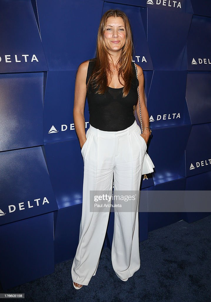 Actress <a gi-track='captionPersonalityLinkClicked' href=/galleries/search?phrase=Kate+Walsh+-+Actress&family=editorial&specificpeople=4111564 ng-click='$event.stopPropagation()'>Kate Walsh</a> attends the Delta Air Lines summer celebration In Beverly Hills on August 15, 2013 in Beverly Hills, California.