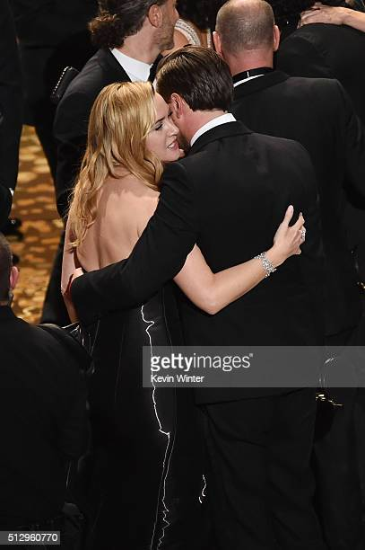 Actress Kate Winslet and actor Leonardo DiCaprio winner of the Best Actor award for 'The Revenant' celebrate onstage during the 88th Annual Academy...