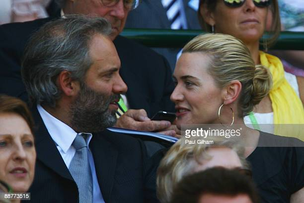 Actress Kate Winslet and husband director Sam Mendes sit on Centre Court on Day Nine of the Wimbledon Lawn Tennis Championships at the All England...