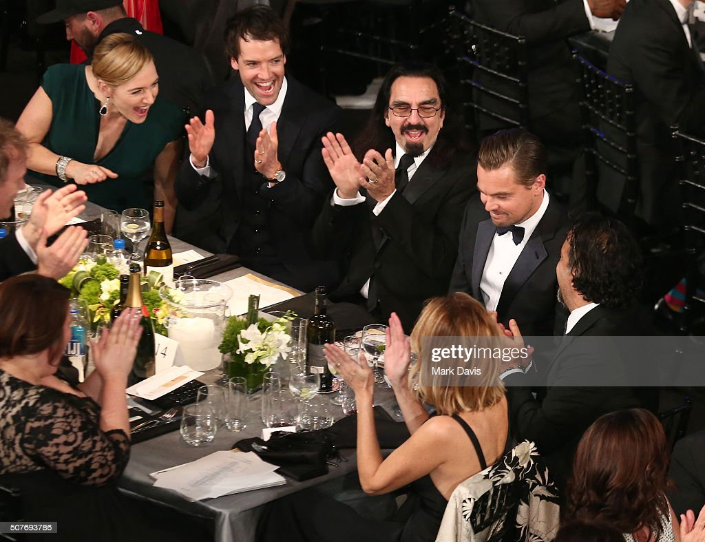 Actress Kate Winslet and the table congratulate actor Leonardo DiCaprio on his win for Outstanding Performance by a Male Actor in a Leading Role for...