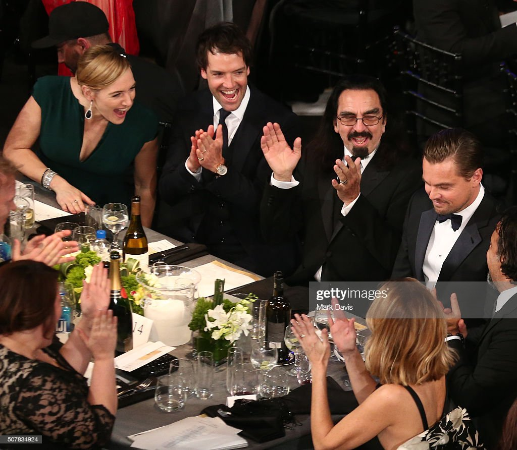 Actress Kate Winslet (L) and the table congratulate actor Leonardo DiCaprio on his win for Outstanding Performance by a Male Actor in a Leading Role for 'The Revenant' during The 22nd Annual Screen Actors Guild Awards at The Shrine Auditorium on January 30, 2016 in Los Angeles, California.