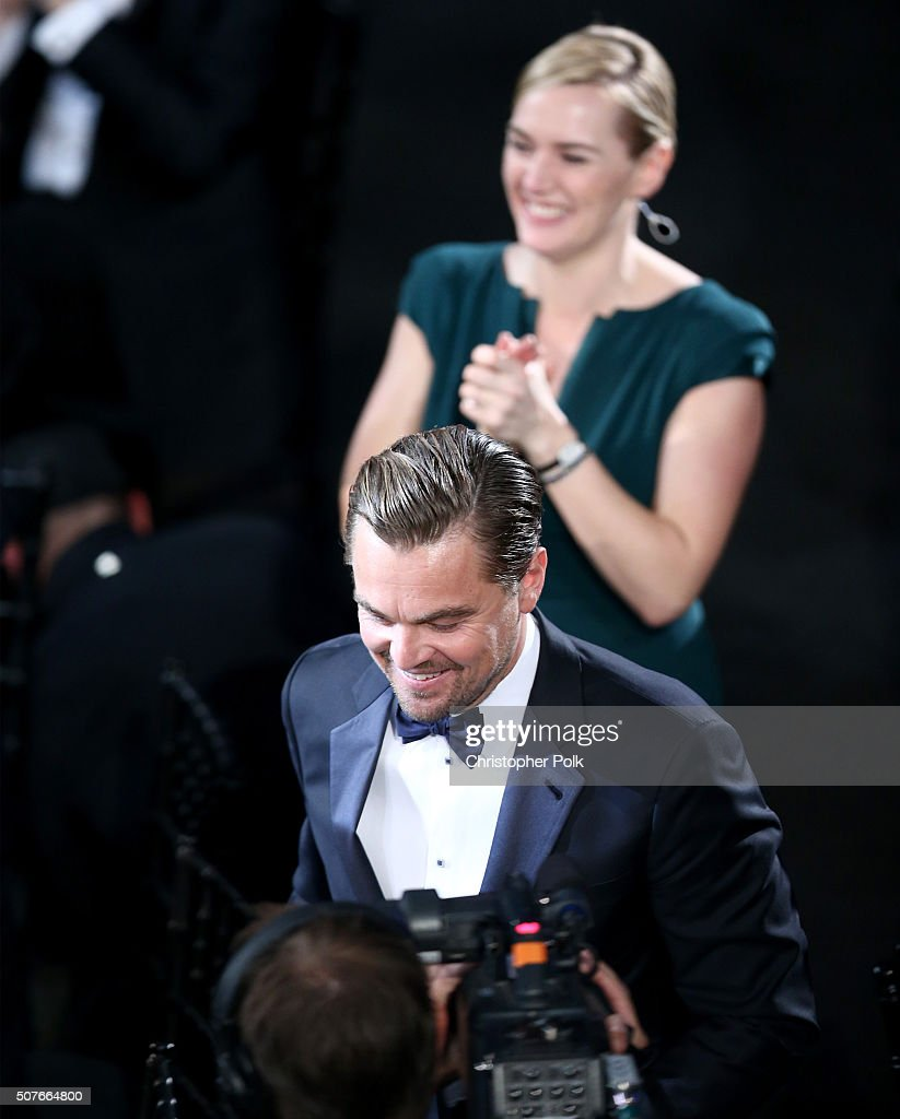 Actress Kate Winslet applauds as actor Leonardo DiCaprio accepts the award for Outstanding Performance by a Male Actor in a Leading Role for 'The...