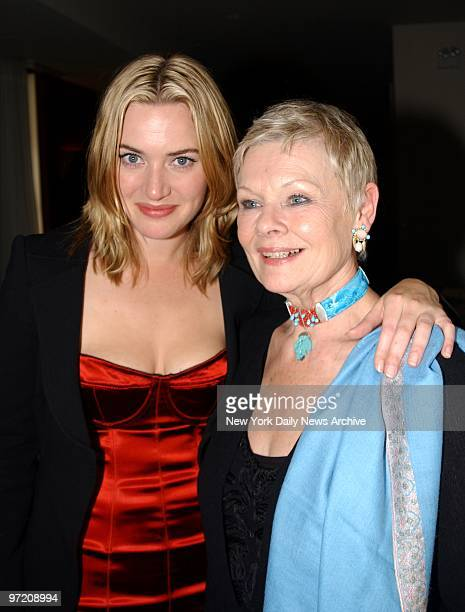 Actress Kate Winslet gets together with Dame Judi Dench at the world premiere of the movie 'Iris' at the Paris Theater They star in the film