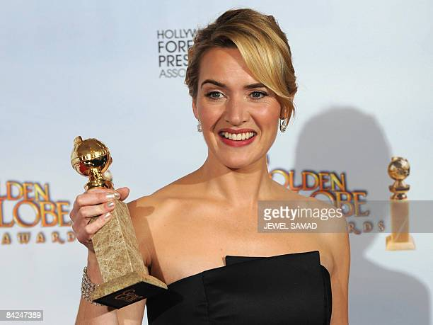 Actress Kate Winslet holds her award for winning Best Performance by an Actress in a Supporting Role in a Motion Picture for 'The Reader' at the 66th...