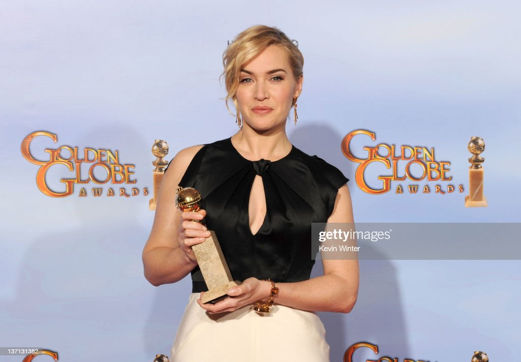 Actress Kate Winslet poses in the press room with the Best Performance by an Actress in a MiniSeries or a Motion Picture Made for Television award...