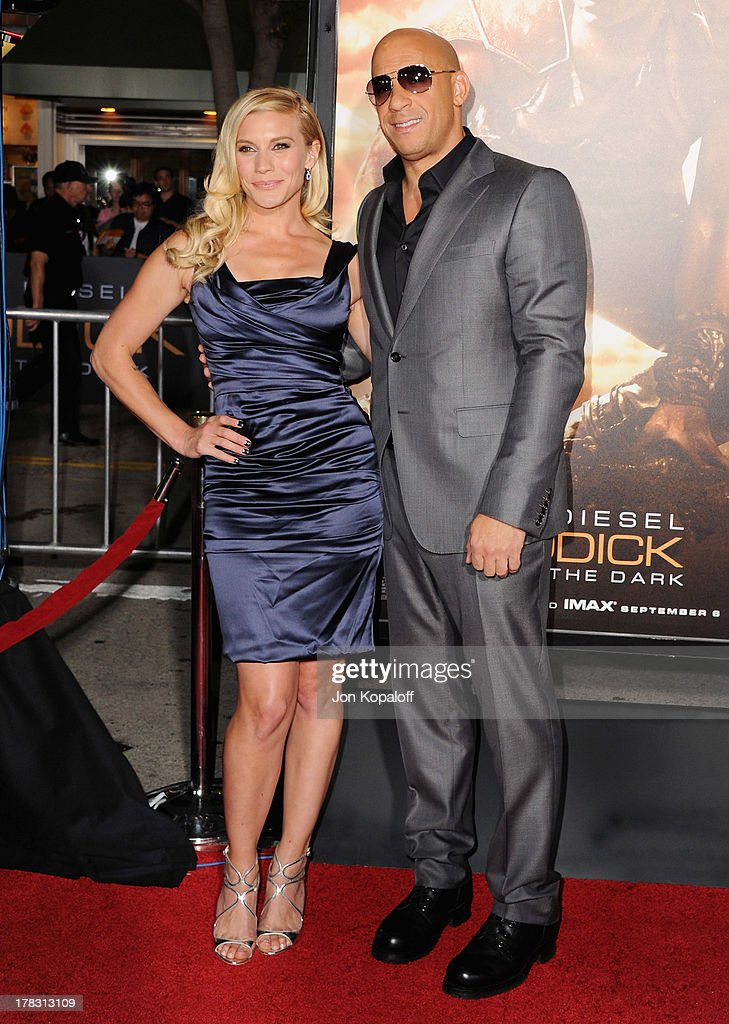 Actress Katee Sackhoff and actor Vin Diesel arrive at the Los Angeles Premiere 'Riddick' at the Mann Village Theater on August 28, 2013 in Westwood, California.
