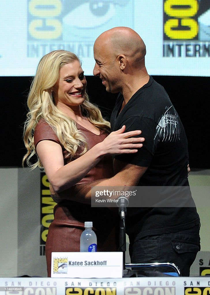 Actress Katee Sackhoff (L) and actor Vin Diesel speak onstage at the 'Kick-Ass 2' and 'Riddick' Panels during Comic-Con International 2013 at San Diego Convention Center on July 19, 2013 in San Diego, California.