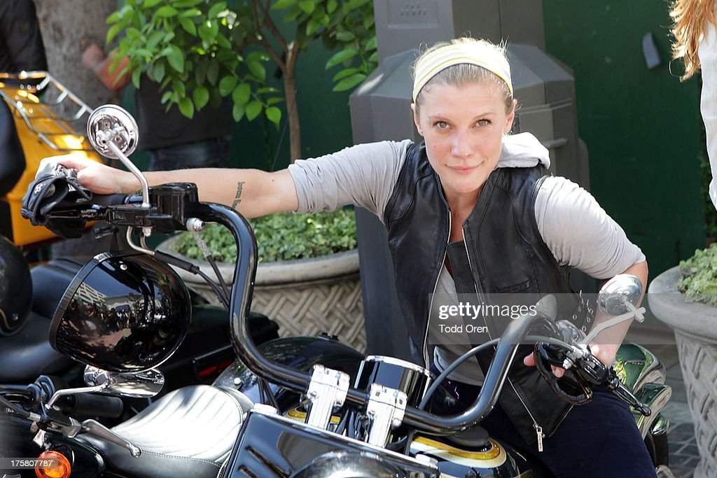 Actress <a gi-track='captionPersonalityLinkClicked' href=/galleries/search?phrase=Katee+Sackhoff&family=editorial&specificpeople=2310579 ng-click='$event.stopPropagation()'>Katee Sackhoff</a> poses at the Kiehl's Since 1851 Liferide For amfAR at The Grove on August 8, 2013 in Los Angeles, California.