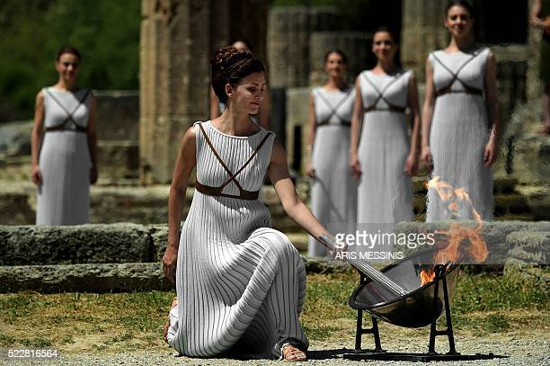 Actress Katerina Lechou acting the high pristess lights the Olympic flame at the Temple of Hera on April 21 2016 during the lighting ceremony of the...