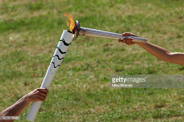 Actress Katerina Lechou acting the high pristess passes the flame from the Olympic Torch at the Ancient Stadium during the Rehearsal for the Lighting...