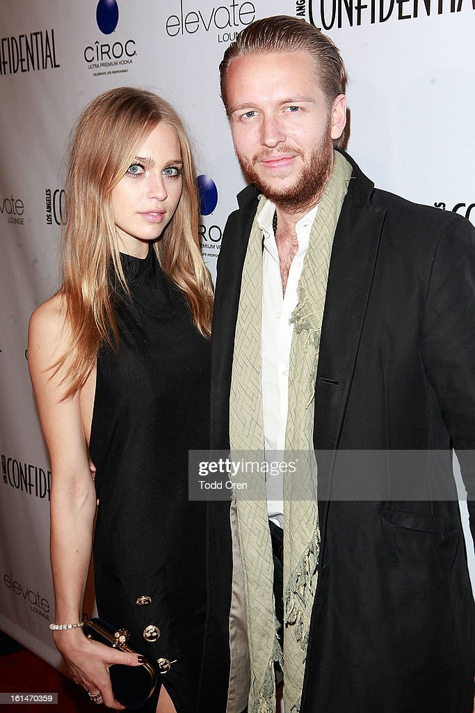 Actress Katharina Damm and Michael Lillelund poses at the Los Angeles Confidential Celebrate THE GRAMMYS at Elevate Lounge on February 10, 2013 in Los Angeles, California.