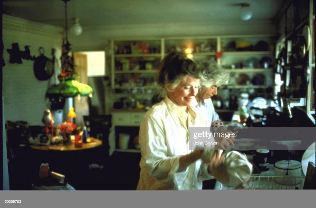 Actress Katharine Hepburn w. her secretary Phyllis Wilbourn preparing dinner.