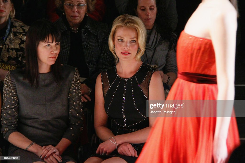Actress <a gi-track='captionPersonalityLinkClicked' href=/galleries/search?phrase=Katherine+Heigl&family=editorial&specificpeople=206952 ng-click='$event.stopPropagation()'>Katherine Heigl</a> (R) and her guest attend Jenny Packham Fall 2013 Mercedes-Benz Fashion Show at The Studio at Lincoln Center on February 12, 2013 in New York City.