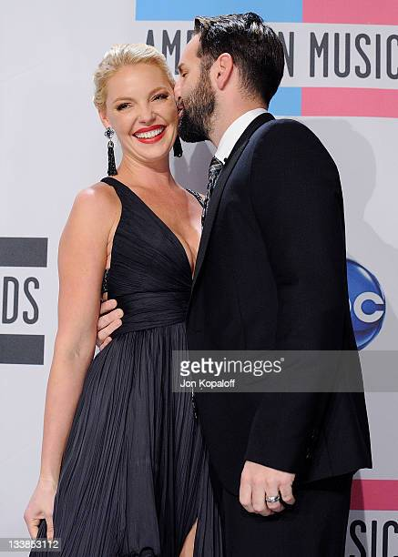 Actress Katherine Heigl and husband recording artist Josh Kelley pose at the 2011 American Music Awards Press Room at Nokia Theatre LA Live on...