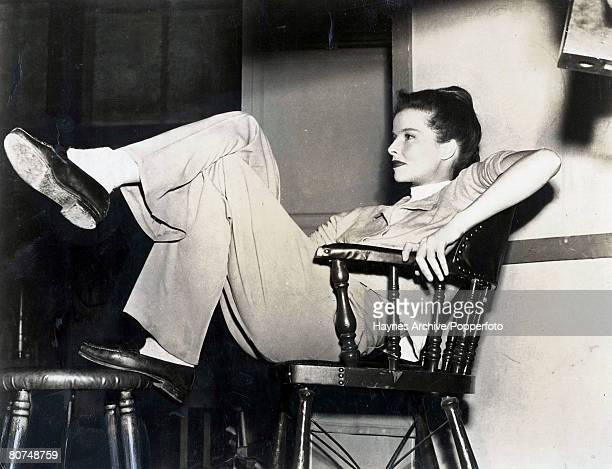 1947 US actress Katherine Hepburn relaxes between scenes of the making of a new MetroGoldwynMayer film