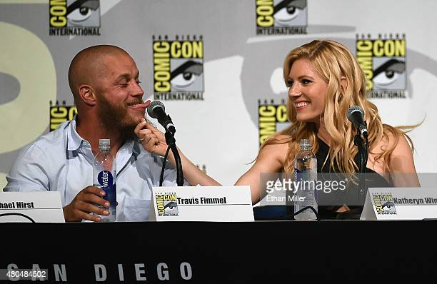 Actress Katheryn Winnick pulls on actor Travis Fimmel's beard as they joke around during a panel for the History series 'Vikings' during ComicCon...