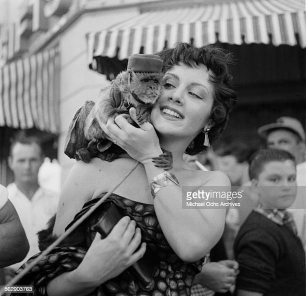 Actress Kathleen Case poses with a monkey during the Opening day of Disneyland in AnaheimCalifornia