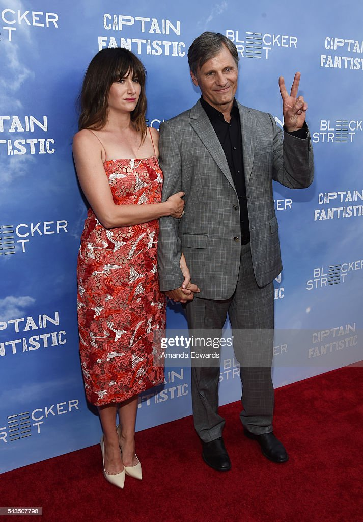 Actress <a gi-track='captionPersonalityLinkClicked' href=/galleries/search?phrase=Kathryn+Hahn&family=editorial&specificpeople=221548 ng-click='$event.stopPropagation()'>Kathryn Hahn</a> (L) and actor <a gi-track='captionPersonalityLinkClicked' href=/galleries/search?phrase=Viggo+Mortensen&family=editorial&specificpeople=239525 ng-click='$event.stopPropagation()'>Viggo Mortensen</a> arrive at the premiere of Bleecker Street Media's 'Captain Fantastic' at Harmony Gold on June 28, 2016 in Los Angeles, California.