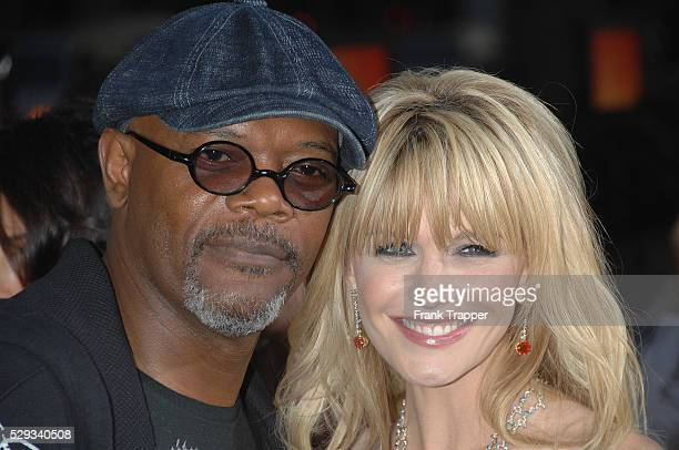 Actress Kathryn Morris and actor Samuel L Jackson arrive at the premiere of 'Resurrecting The Champ' held at the Academy of Motion Picture Arts...