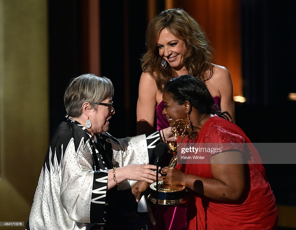 Actress Kathy Bates accepts Outstanding Supporting Actress in a Miniseries or Movie for 'American Horror Story: Coven' from actresses Octavia Spencer and Allison Janney onstage at the 66th Annual Primetime Emmy Awards held at Nokia Theatre L.A. Live on August 25, 2014 in Los Angeles, California.