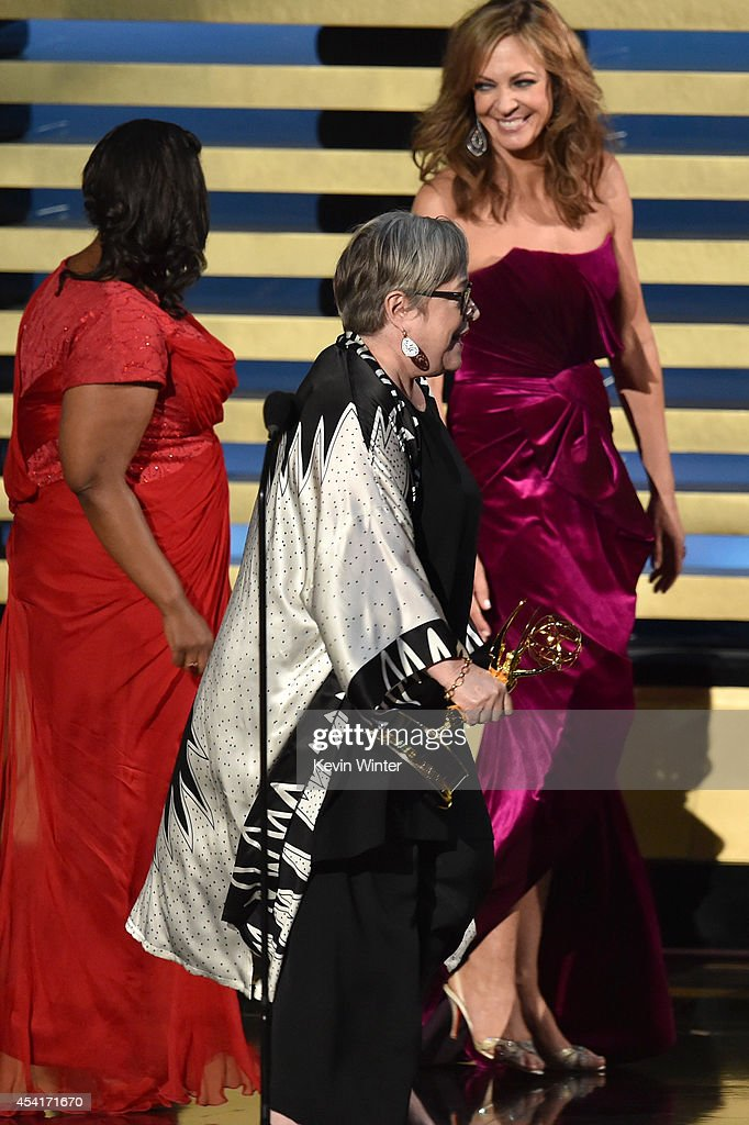 Actress Kathy Bates (C) accepts Outstanding Supporting Actress in a Miniseries or Movie for 'American Horror Story: Coven' from actresses Octavia Spencer and Allison Janney onstage at the 66th Annual Primetime Emmy Awards held at Nokia Theatre L.A. Live on August 25, 2014 in Los Angeles, California.