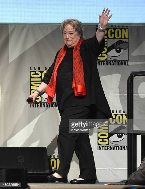 Actress Kathy Bates walks onstage at the 'American Horror Story' and 'Scream Queens' panel during ComicCon International 2015 at the San Diego...