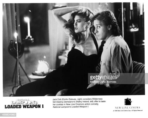 Actress Kathy Ireland and actor Emilio Estevez on set of the New Line Cinema movie 'Loaded Weapon 1' circa 1993