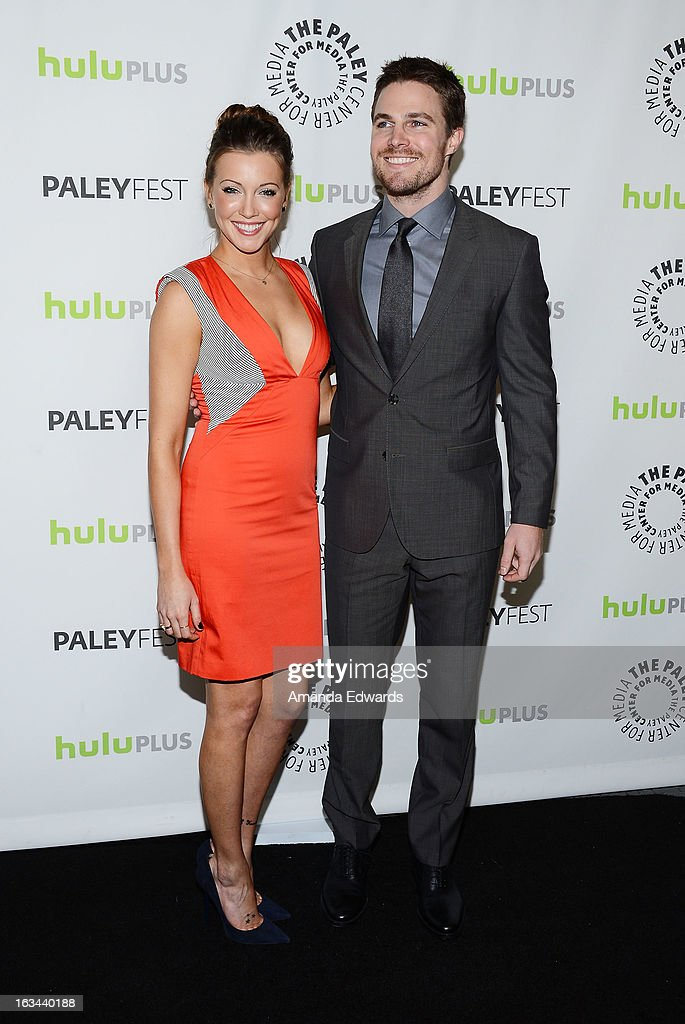 Actress <a gi-track='captionPersonalityLinkClicked' href=/galleries/search?phrase=Katie+Cassidy&family=editorial&specificpeople=569891 ng-click='$event.stopPropagation()'>Katie Cassidy</a> (L) and actor <a gi-track='captionPersonalityLinkClicked' href=/galleries/search?phrase=Stephen+Amell&family=editorial&specificpeople=4500297 ng-click='$event.stopPropagation()'>Stephen Amell</a> arrive at the 30th Annual PaleyFest: The William S. Paley Television Festival featuring 'Arrow' at the Saban Theatre on March 9, 2013 in Beverly Hills, California.