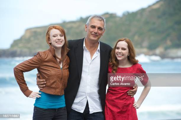 Actress Katie Cosini director Laurent Cantet and actress Madeleine Bisson attend the 'Fosfire' photocall at the Kursaal Palace during the 60th San...