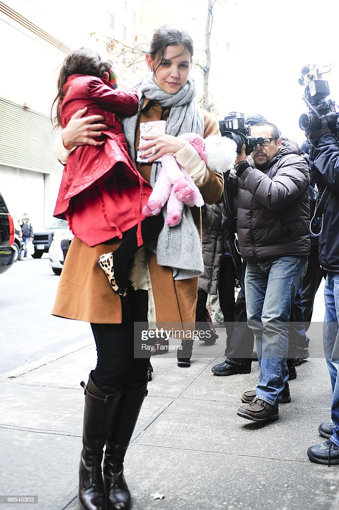 Actress <a gi-track='captionPersonalityLinkClicked' href=/galleries/search?phrase=Katie+Holmes&family=editorial&specificpeople=201598 ng-click='$event.stopPropagation()'>Katie Holmes</a> (R) and her daughter <a gi-track='captionPersonalityLinkClicked' href=/galleries/search?phrase=Suri+Cruise&family=editorial&specificpeople=4029470 ng-click='$event.stopPropagation()'>Suri Cruise</a> enter their Greenwich Village home on February 09, 2010 in New York City.