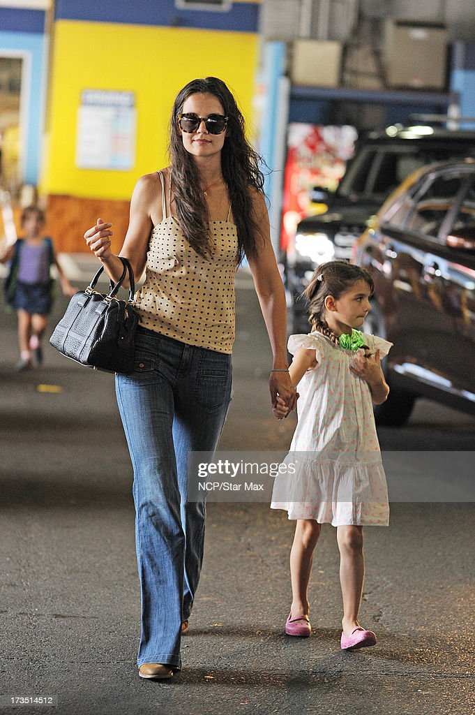 Actress <a gi-track='captionPersonalityLinkClicked' href=/galleries/search?phrase=Katie+Holmes&family=editorial&specificpeople=201598 ng-click='$event.stopPropagation()'>Katie Holmes</a> and <a gi-track='captionPersonalityLinkClicked' href=/galleries/search?phrase=Suri+Cruise&family=editorial&specificpeople=4029470 ng-click='$event.stopPropagation()'>Suri Cruise</a> as seen on July 15, 2013 in New York City.
