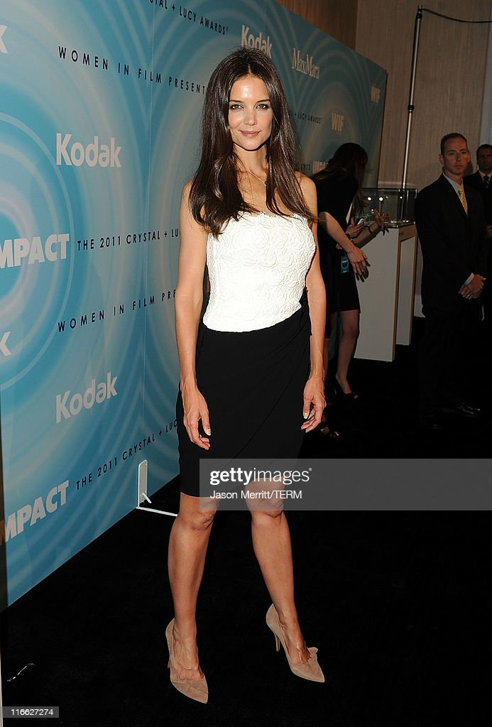 Actress <a gi-track='captionPersonalityLinkClicked' href=/galleries/search?phrase=Katie+Holmes&family=editorial&specificpeople=201598 ng-click='$event.stopPropagation()'>Katie Holmes</a> arrives at the 2011 Women In Film Crystal + Lucy Awards with presenting sponsor PANDORA jewelry at the Beverly Hilton Hotel on June 16, 2011 in Beverly Hills, California.