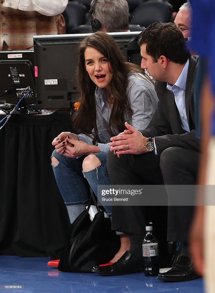 Actress Katie Holmes attends the game between the New York Knicks and the Golden State Warriors at Madison Square Garden on February 27, 2013 in New York City.