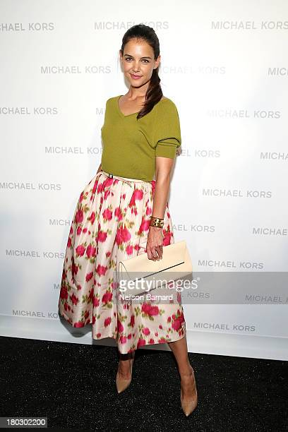 Actress Katie Holmes poses backstage at the Michael Kors fashion show during MercedesBenz Fashion Week Spring 2014 at The Theatre at Lincoln Center...