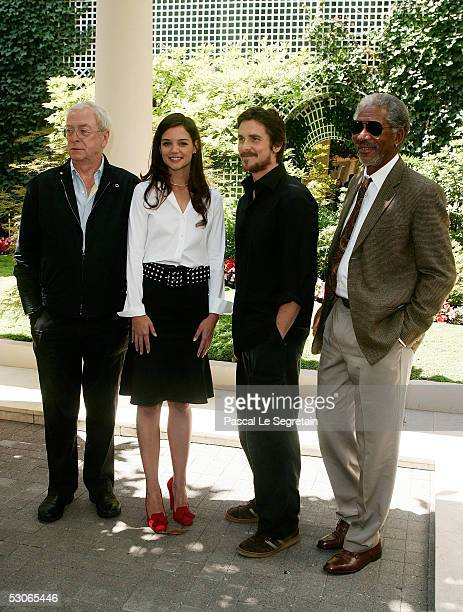 Actress Katie Holmes poses with actors Michael Caine Christian Bale and Morgan Freeman during a photocall for Batman begins on June 14 2005 in Paris...