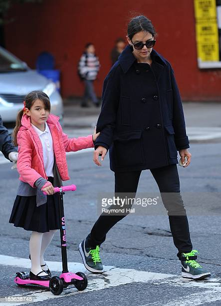 Actress Katie Holmes sighted helping Suri Cruise to scooter in Chelsea on October 8 2013 in New York City