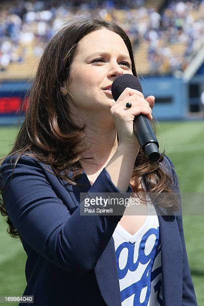 Actress Katie Lowes sings God Bless America before the Los Angeles Dodgers game against the Pittsburgh Pirates on April 7 2013 at Dodger Stadium in...