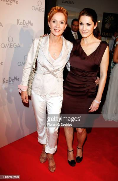 Actress Katja Flint and actress countess Mariella von FaberCastell attend the 'Omega Ladymatic Cocktail' at KaDeWe on June 6 2011 in Berlin Germany