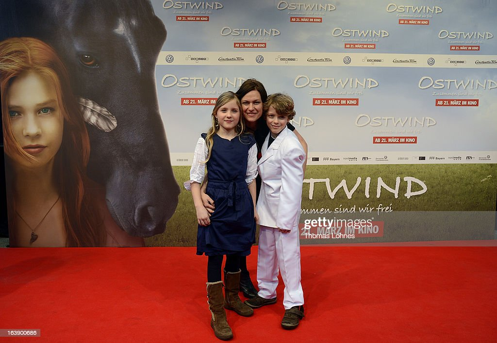 Actress Katja Kronjaeger with her children Lucille and Lennon attend the premiere of the film 'Ostwind' on March 17, 2013 in Frankfurt am Main, Germany. The family film portrays the friendship between the young Mika and the wild and shy stallion 'Ostwind' (east wind). Katja Kronjaeger is seen als 'Nikas mother' in the film