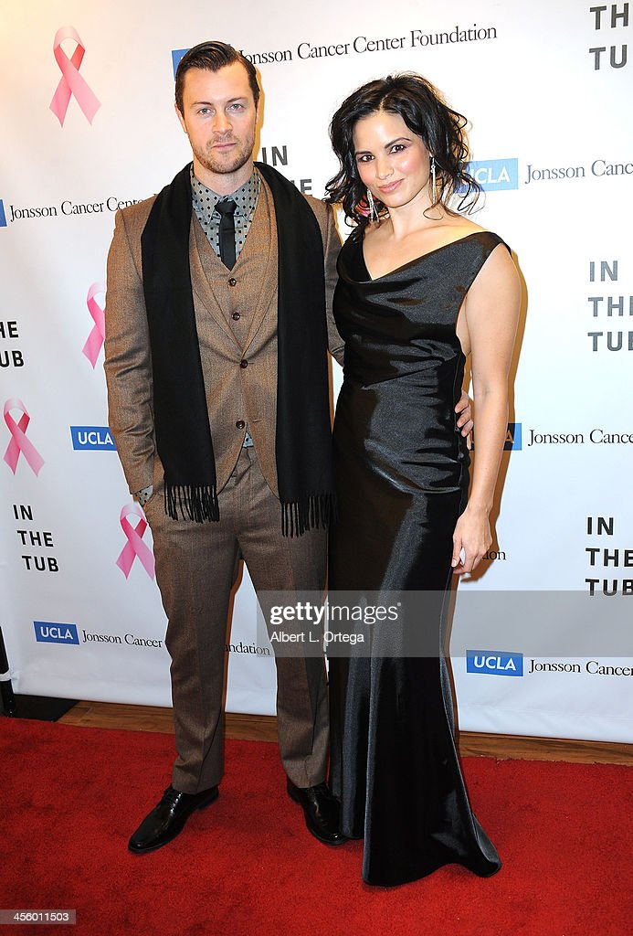 Actress Katrina Law and actor Dan Feurriegel attend TJ Scott's 'In The Tub' Book Party Launch to benefit UCLA's Jonsson Cancer Center for Breast Research hosted by Katrina Law of 'Spartacus' held at Light In Art on December 12, 2013 in Los Angeles, California.