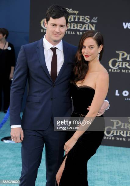 Actress Kaya Scodelario and Benjamin Walker arrive at the premiere of Disney's 'Pirates Of The Caribbean Dead Men Tell No Tales' at Dolby Theatre on...