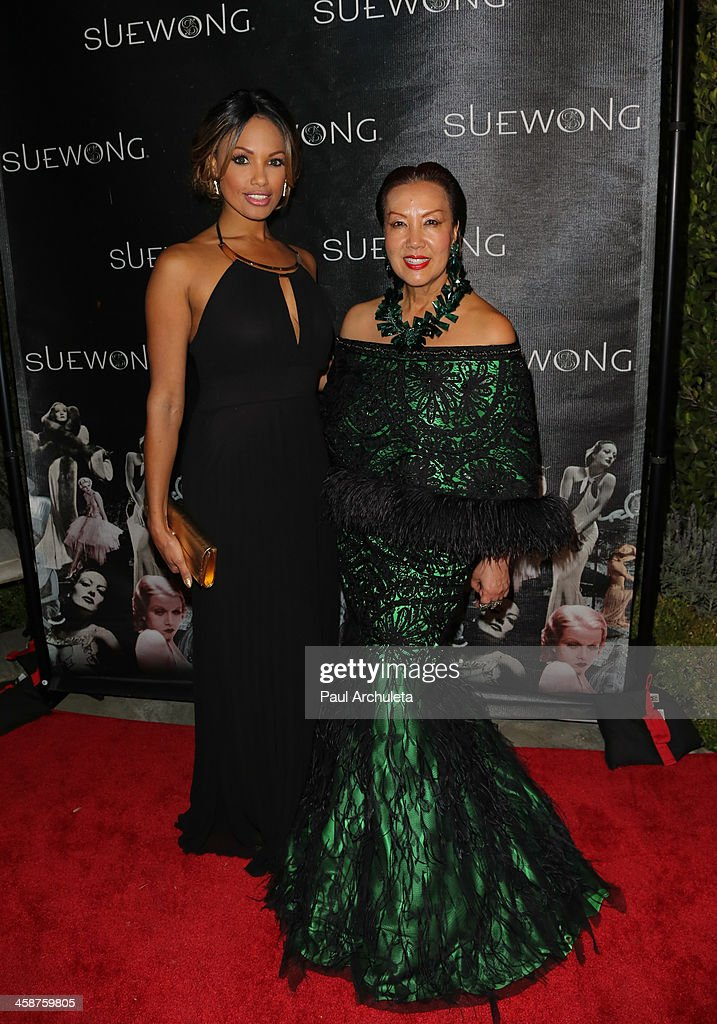 Actress K.D. Aubert (L) and Fashion Designer Sue Wong (R) attend Sue Wong's holiday party on December 20, 2013 in Los Angeles, California.