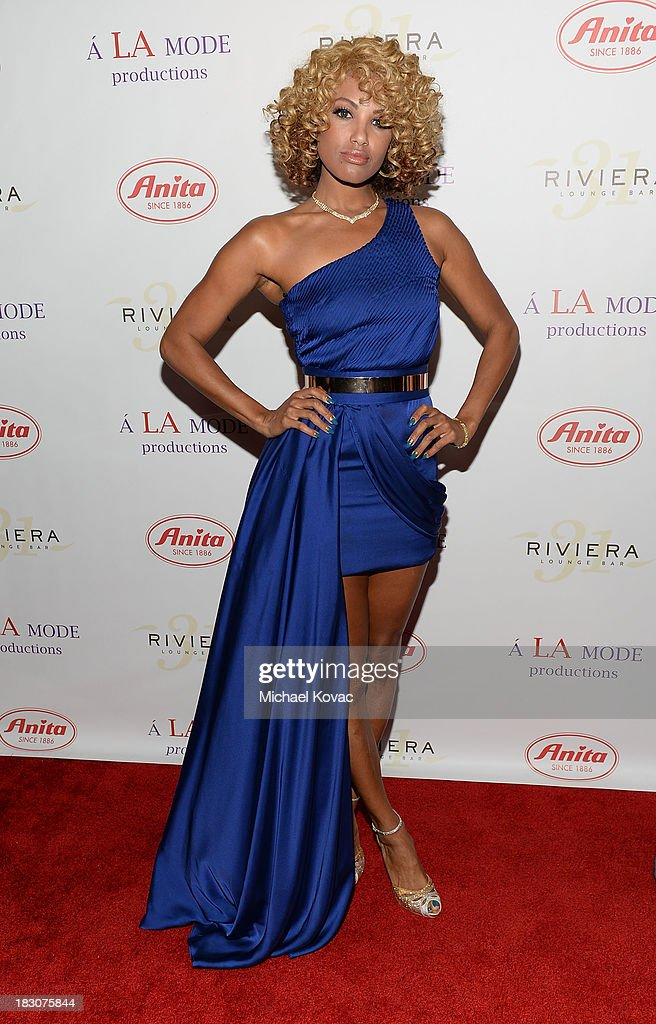 Actress KD Aubert arrives for A la mode Productions Presents Designers Night Out at Sofitel Hotel on October 3, 2013 in Los Angeles, California.