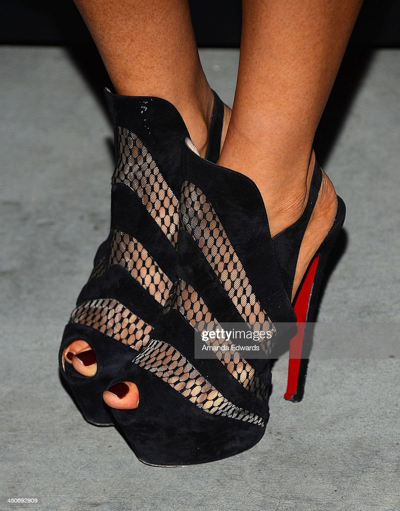 Actress Kea Ho (shoe detail) arrives at the MINI Cooper red carpet premiere on November 19, 2013 in Los Angeles, California.