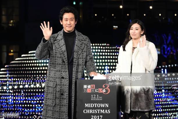 Actress Keiko Kitagawa and actor Yo Oizumi attend the Midtown Christmas 2017 Lighting Ceremony on November 15 2017 in Tokyo Japan