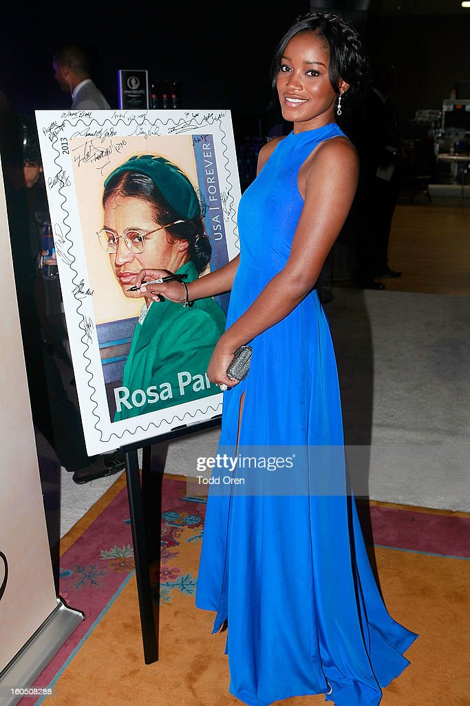 Actress <a gi-track='captionPersonalityLinkClicked' href=/galleries/search?phrase=Keke+Palmer&family=editorial&specificpeople=653121 ng-click='$event.stopPropagation()'>Keke Palmer</a> previews the Rosa Parks Forever Stamp in the U.S. Postal Service Civil Rights Stamp Gallery backstage at the NAACP Image Awards on February 1, 2013 at The Shrine Auditorium.