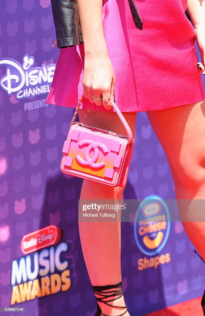 Actress Kelli Berglund, Chanel purse detail, attends the 2016 Radio Disney Music Awards at Microsoft Theater on April 30, 2016 in Los Angeles, California.